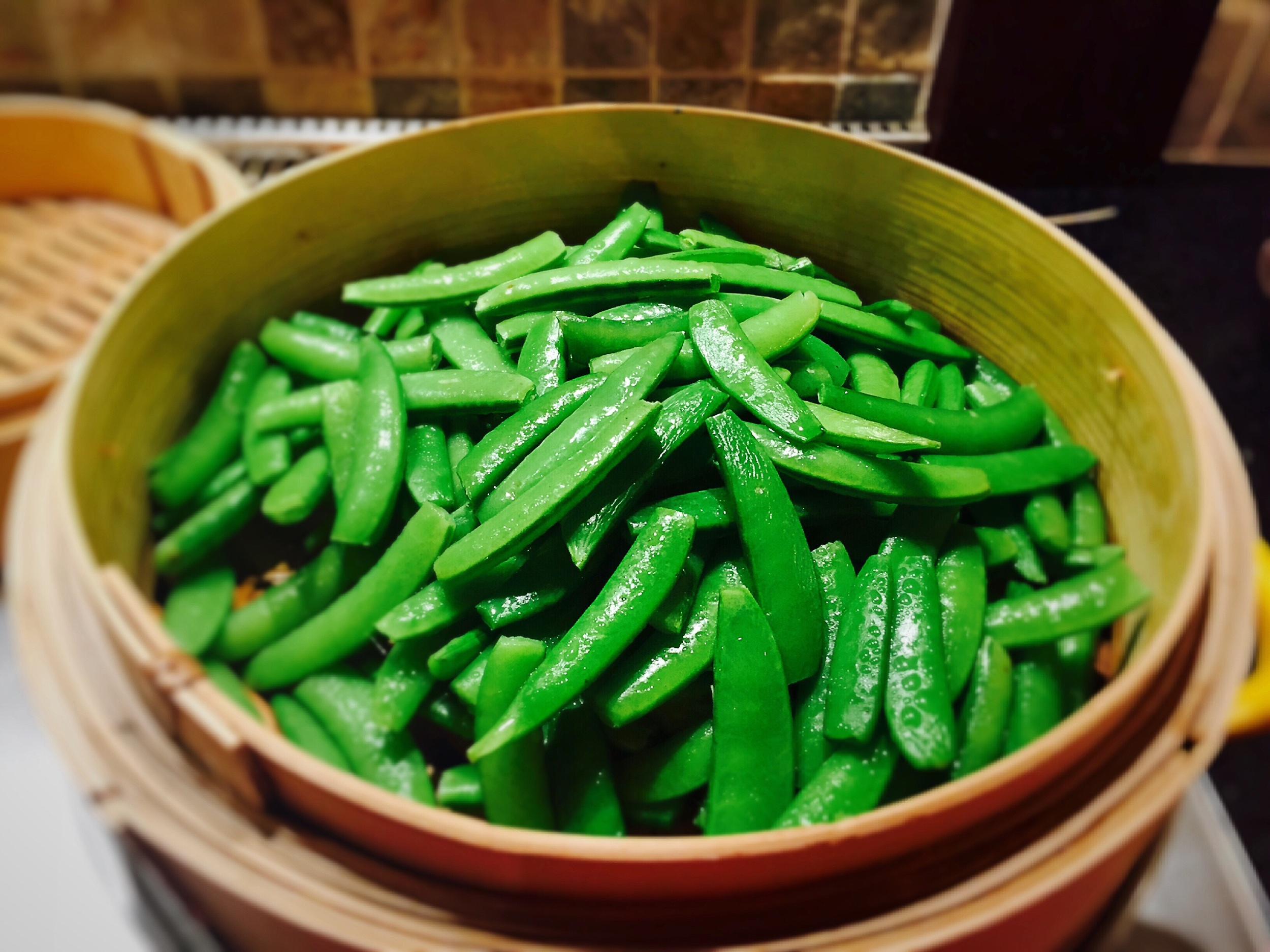 1. Rinse the sugar snap peas and snip the ends from both sides.  2. Place them in your  bamboo steamer , cover, and place over boiling water for approximately 3-4 minutes.   3. Uncover, remove from heat and sprinkle with  Coarse Pink Himalayan Salt (or  Kosher salt )to taste.