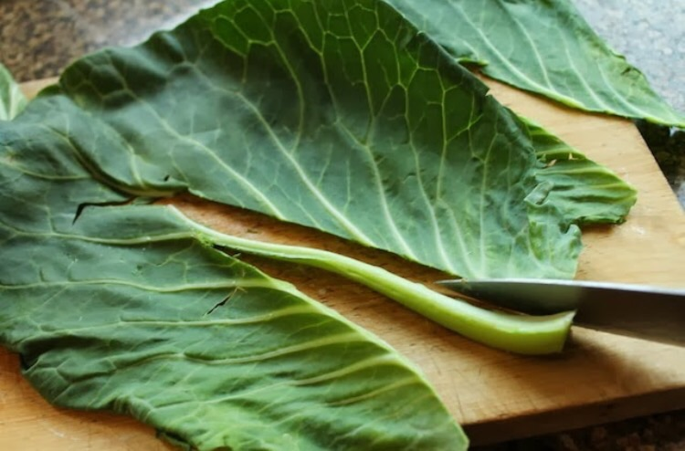 Remove the stems. Note: the tender young leaves in the heart of the collards don't need to be stripped.