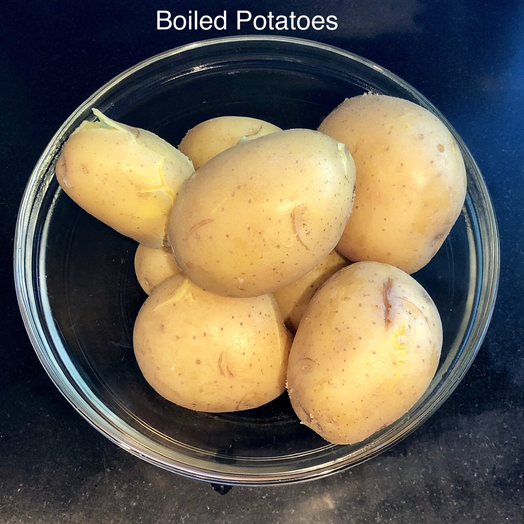 9. Boil the potatoes with skins on. Be careful not to overcook them. If they're different sizes, you may have to remove the smaller ones before the larger ones, as they will cook more quickly. Test them with a fork to check their progress.