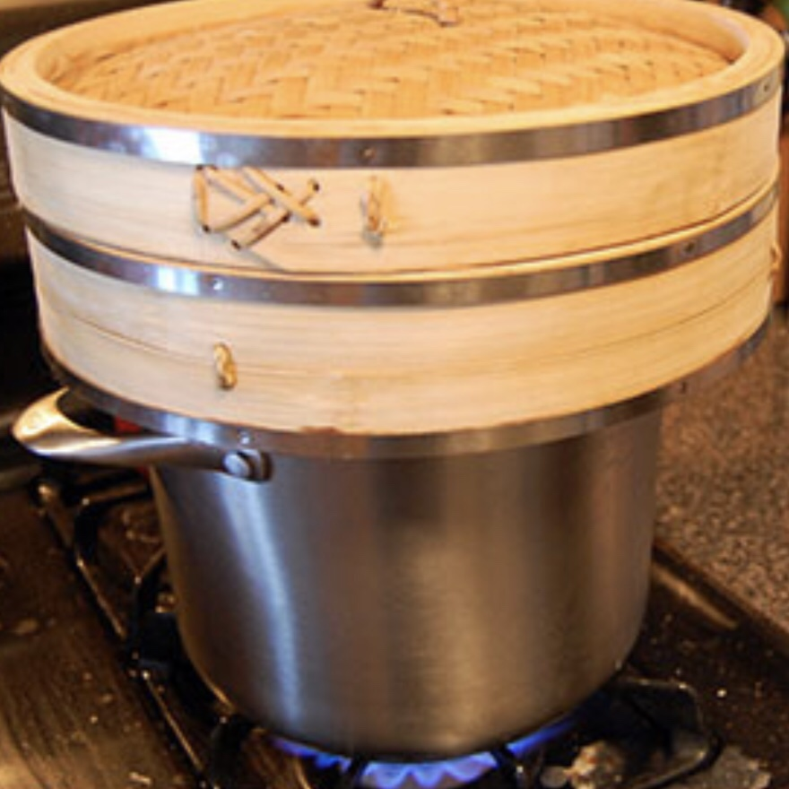 Add the beets to a pot of water, cover, and turn the heat on high. When the water reaches a rolling boil, replace the pot cover with the  bamboo steamer  with the carrots.