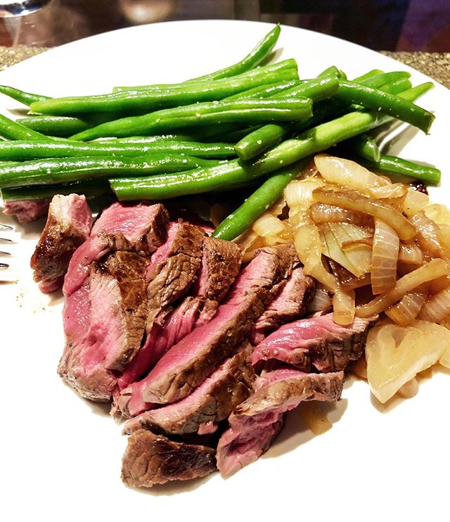"""Want an easy weeknight meal? Just 5 ingredients! This is as simple as it gets. . INGREDIENTS (serves 2) 2️⃣Grass-fed, organic beef fillets 2️⃣Vidalia Onions, cut in half lengthwise, then sliced ⅛-¼"""" thick 1️⃣/2️⃣lb of green beans, cleaned & ends snipped 1️⃣-2️⃣TBS grass-fed butter Borsari Seasoned Salt to taste (tap on link in bio & this image) . DIRECTIONS 🥕Remove the steaks from the refrigerator & season them with Borsari Seasoned Salt (my current obsession-link in bio). Set aside & let them ready for at least 30 minutes before cooking. 🥕Melt about 1 TBS of butter in a cast iron skillet set over a medium flame and add the onion slices. Stir to coat them with the butter, and continue to stir them every 5-10 minutes. 🥕Once the onions start to deepen in color, stir them more frequently to ensure no onions burn at the bottom. I sautéed mine for about 30-40 minutes, but you can go longer if you liked a more carmelized taste. 🥕Prep & clean the green beans. Steam them for about 5-7 minutes (I use a bamboo steamer) and then toss them with kosher salt and grass-fed butter. 🥕Move the onions to the side of the pan, continuing to stir, switching up the bottom layer with the top to avoid burning. 🥕Turn the heat up to medium high, add more butter and add the meat. Cook to desired temperature (I like mine medium rare, so about 4-5 minutes per side, depending on steak thickness). 🥕Remove from heat and let the meat stand for a few minutes before cutting into it. This seals in the juices and lashes it more moist. 🥕Serve with the green beans and carmelized onions on the side. . . . . . #easyweeknightdinner #Paleo #Whole30 #whatsfordinner #ketorecipes #dinnerideas #ketomealprep #Whole30recipes #paleorecipes #loseweịght #fatloss #bikinibody #eatorganic #healthyliving #aiprecipes #healthyfoodporn #fitandhealthy #healthyrecipes #ketomeals #meatandveggies #healthycookingmadeeasy #healthymealideas https://amzn.to/2NQibsF ⠀ #newtritionnewyou #newyou #grassfedeverything #filletminon #easyre"""