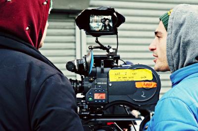 Cinematographer Giacomo Belletti prepares the Arri 416 on set.