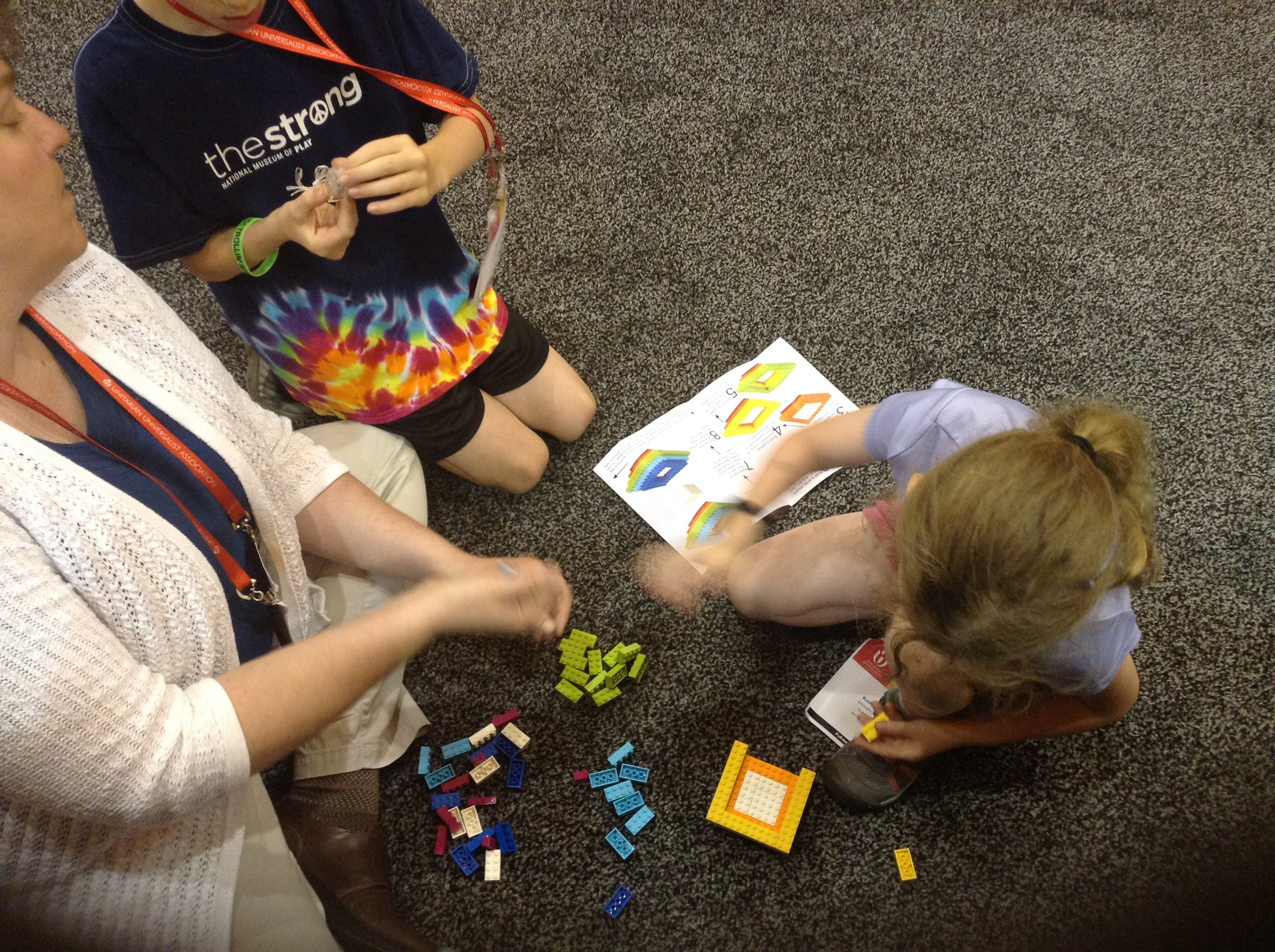 At the 2017 Unitarian Universalist General Assembly, the LEGO Chalice was a hit with kids of all ages. Here is a family taking a break, building the LEGO Chalice at my husband's (UU sculptor Brian Watson) booth.