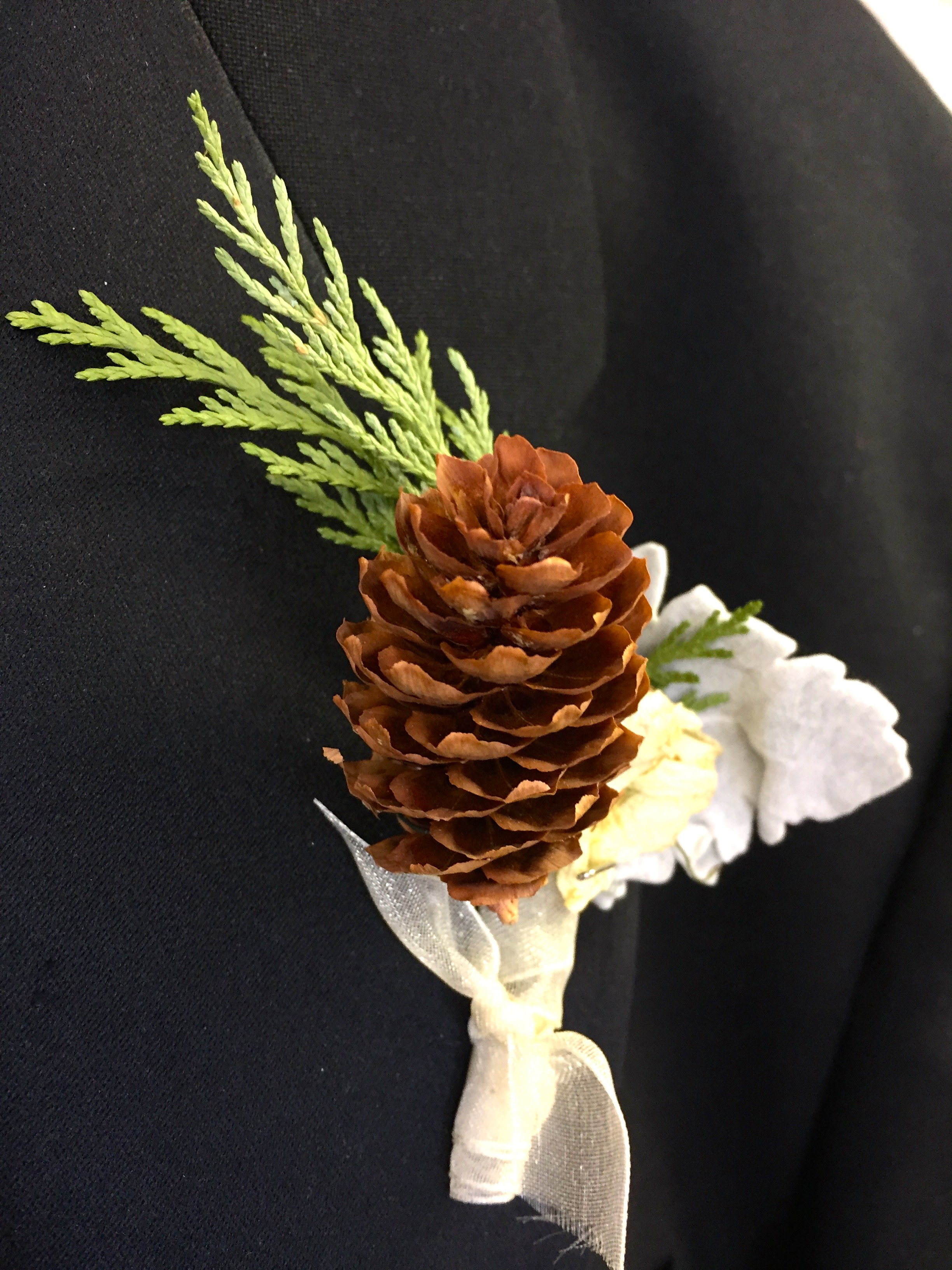 One of my favorite corsages that was left on a groomsman's tux. What a fun idea for a mountain wedding!