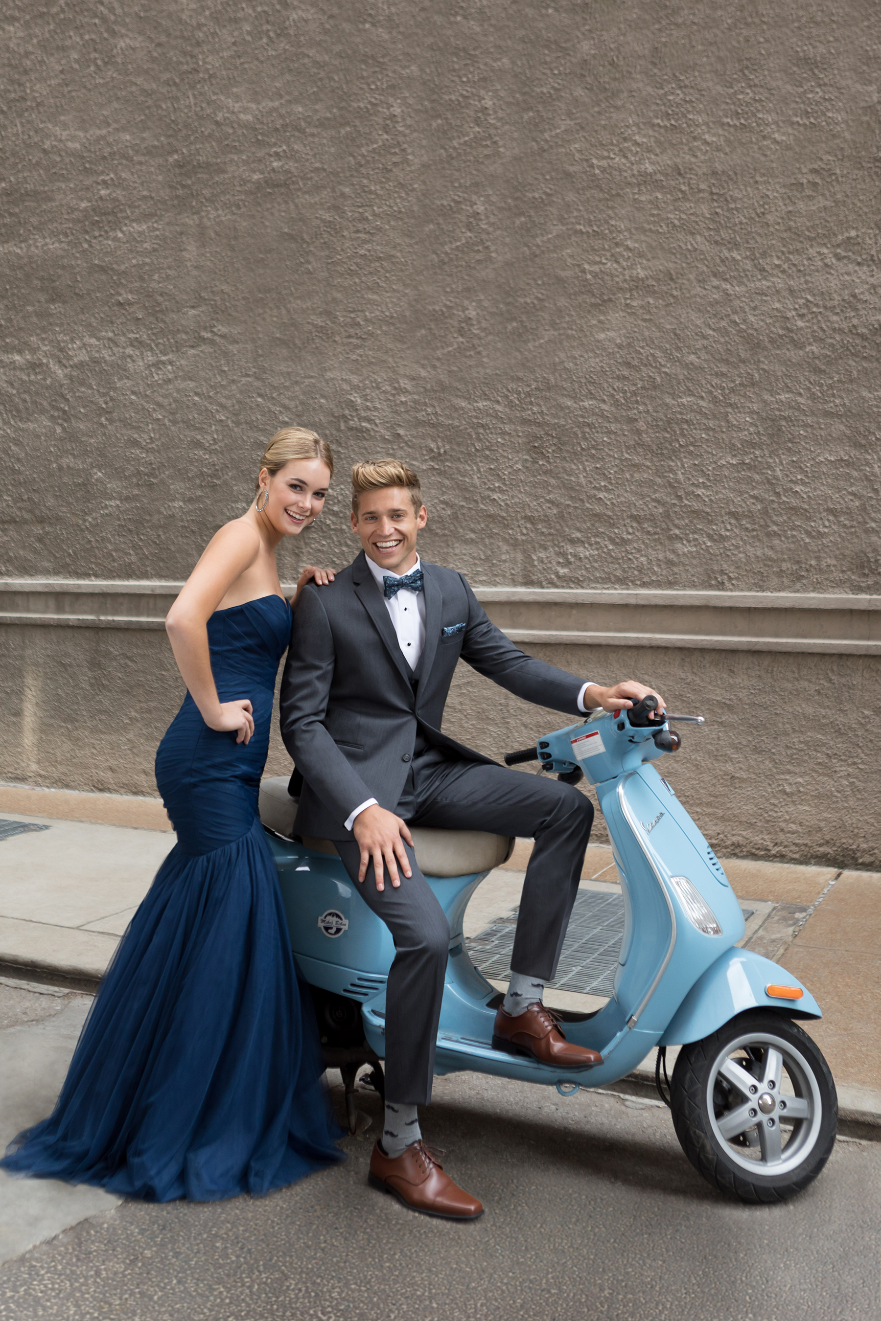 Scoot on in here and order your tuxedo! - (Note: Due to varying weather conditions in the Rocky Mountains, taking your date to prom on a scooter is not recommended.)
