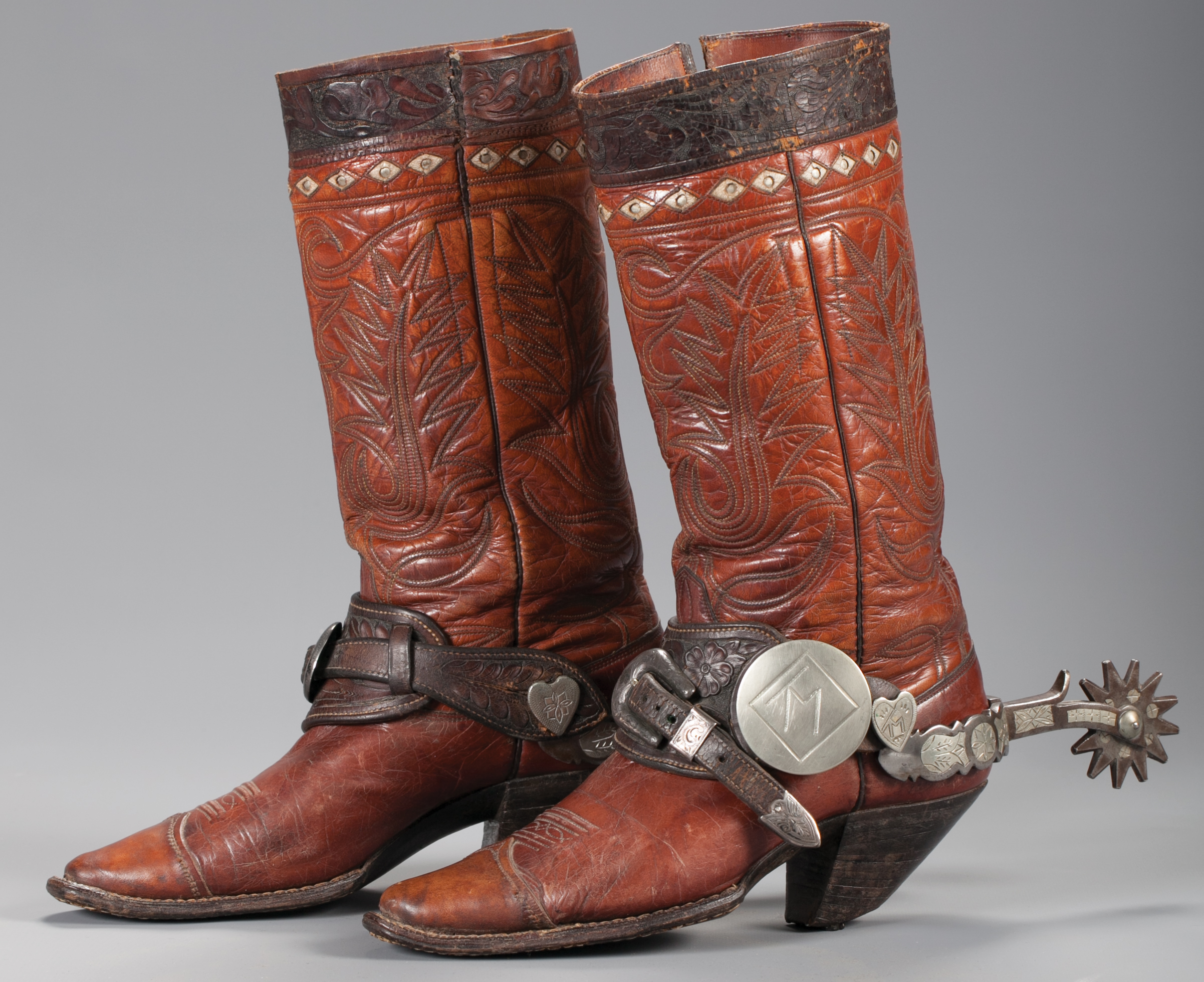 Brian Lebel's Mesa Auction - January 21, 2017   Lot 51: Tom Mix's Personal Cowboy Boots.   Sold $5,175   Lot 52: Bob Baldwin Canon City Spurs made for Tom Mix. Est.   Sold $16,100