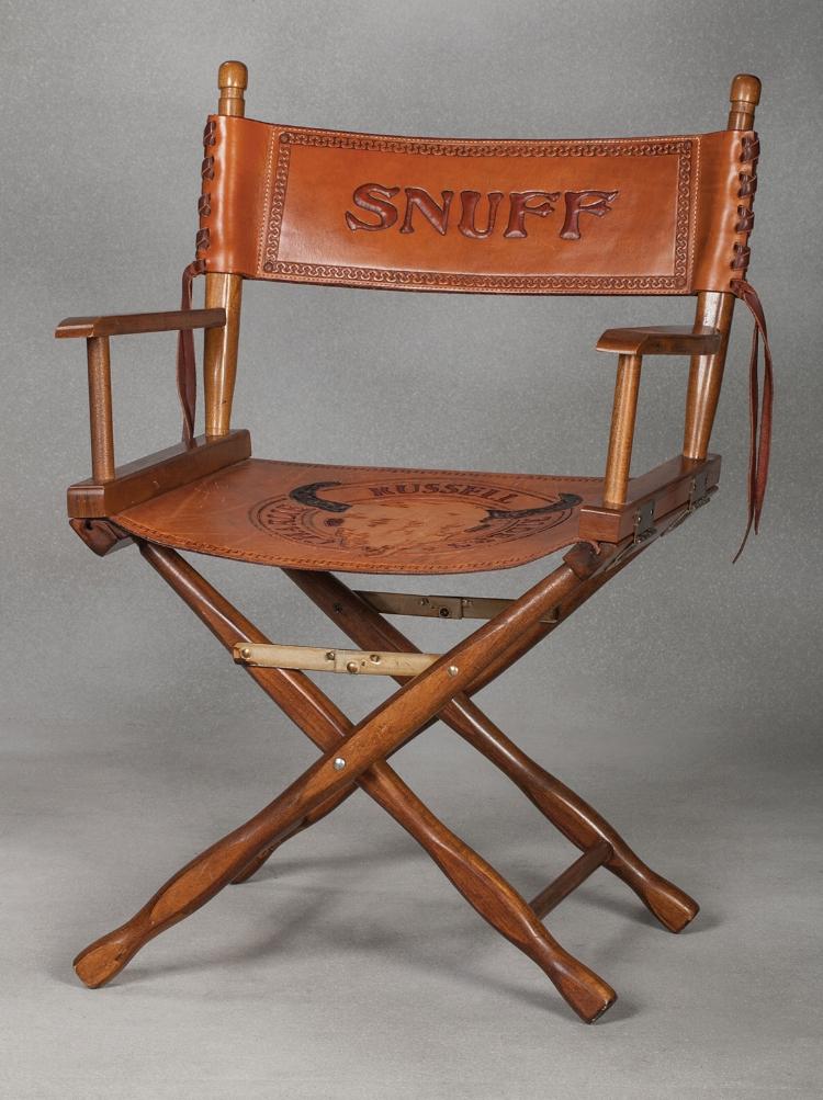 Snuff's custom Charlie Russell Riders Directors Chair. Estimate $800-1,400.