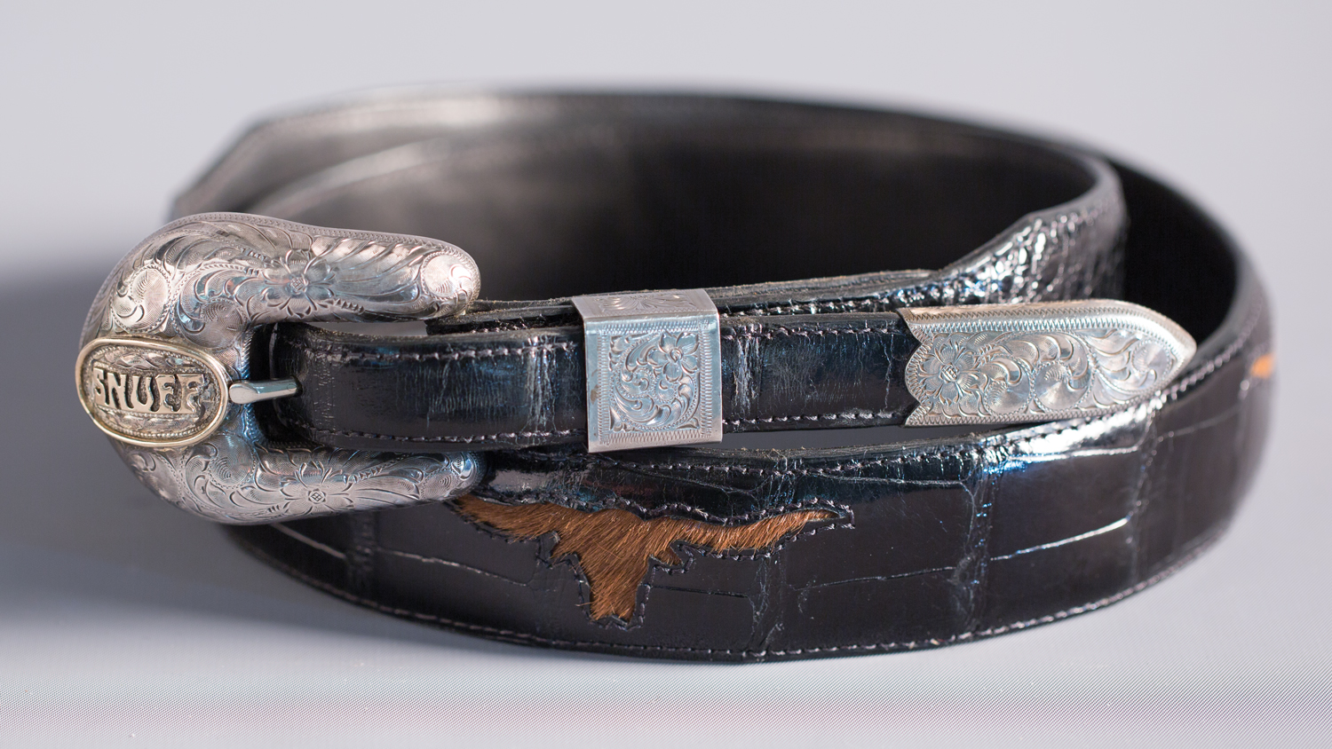 "Lot 72: Edward H. Bohlin ""Snuff"" Buckle Set, Sold $826. Provenance: From the Estate of Snuff Garrett."
