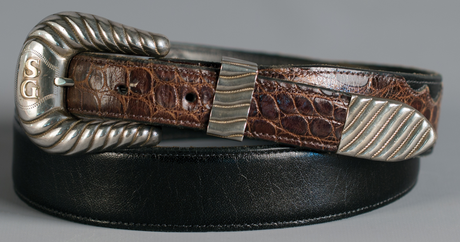 Lot 73: Edward H. Bohlin Cheyenne 3-piece Buckle Set with Two Belts, Sold $944. Provenance: From the Estate of Snuff Garrett.