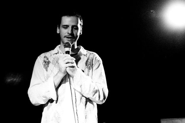 Me performing at Bright Club - where having people laugh at your research is considered a good thing!