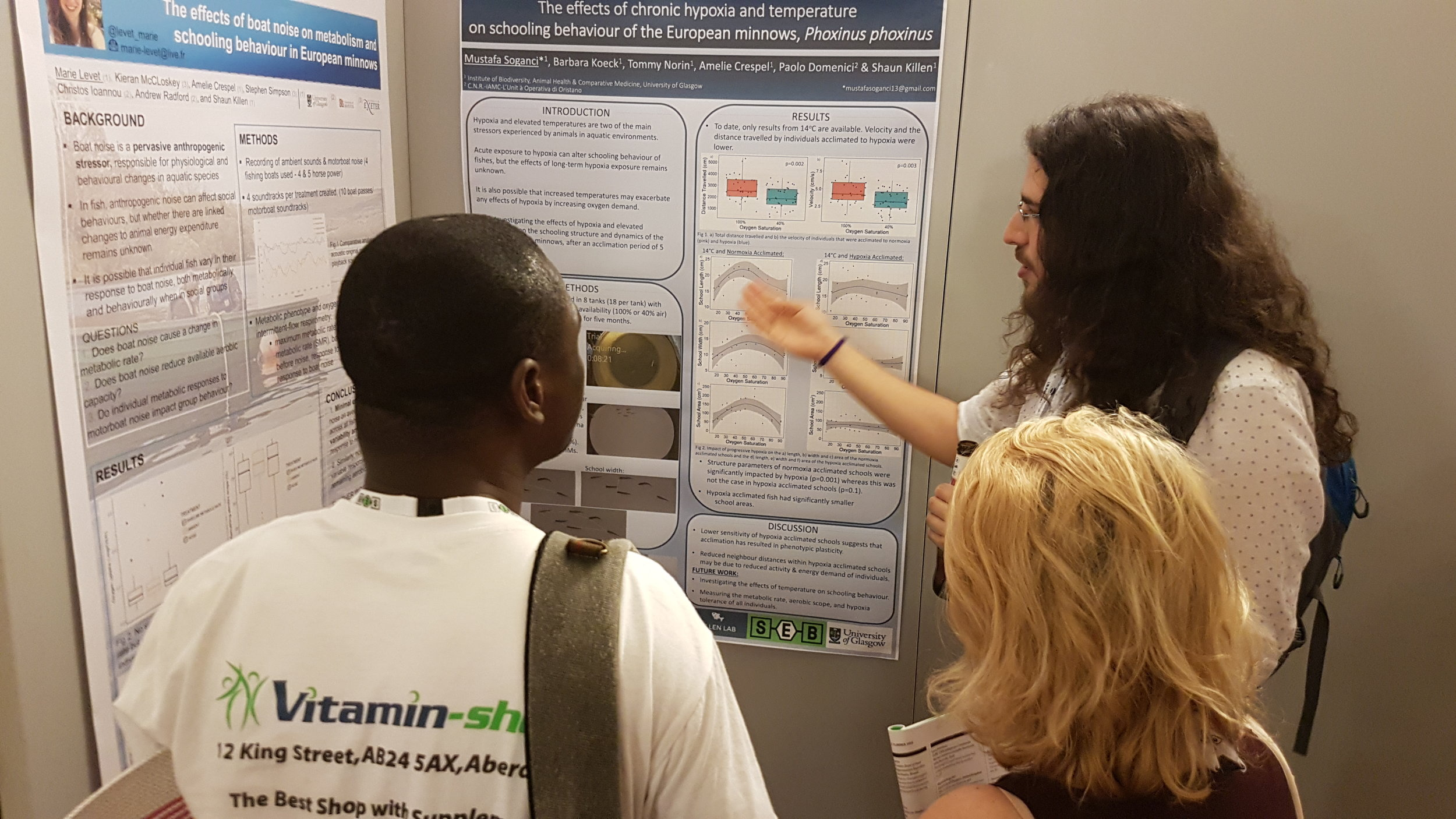 Mustafa Soganci with his poster on how hypoxia affects fish schooling behaviour.
