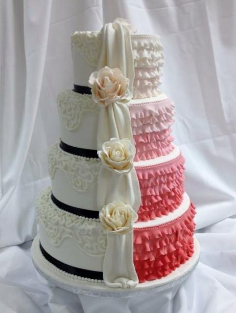 Two sided 4 tier round wedding cake with ruffles _amp_ drape dividing.jpg