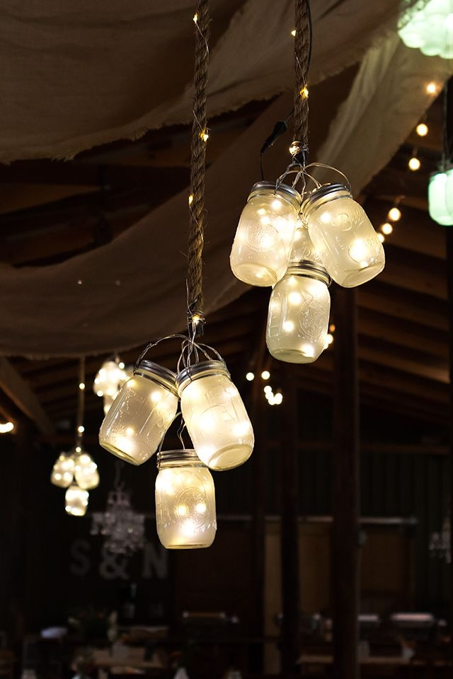 clusters-of-frosted-LED-mason-jar-lights-decor-for-rustic-barn-wedding.jpg