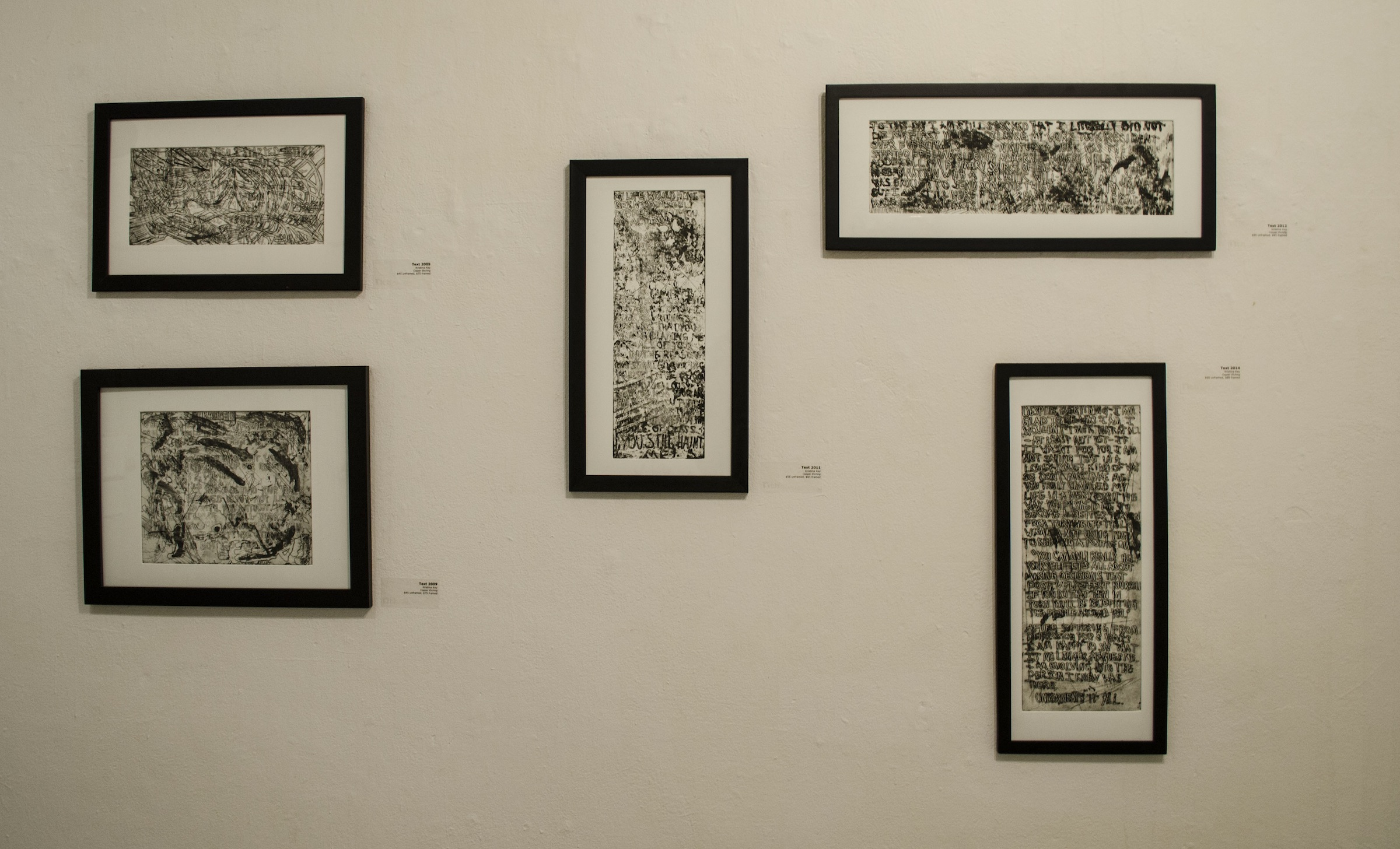 Framed copper etchings with written responses to each section within the installation room  2014