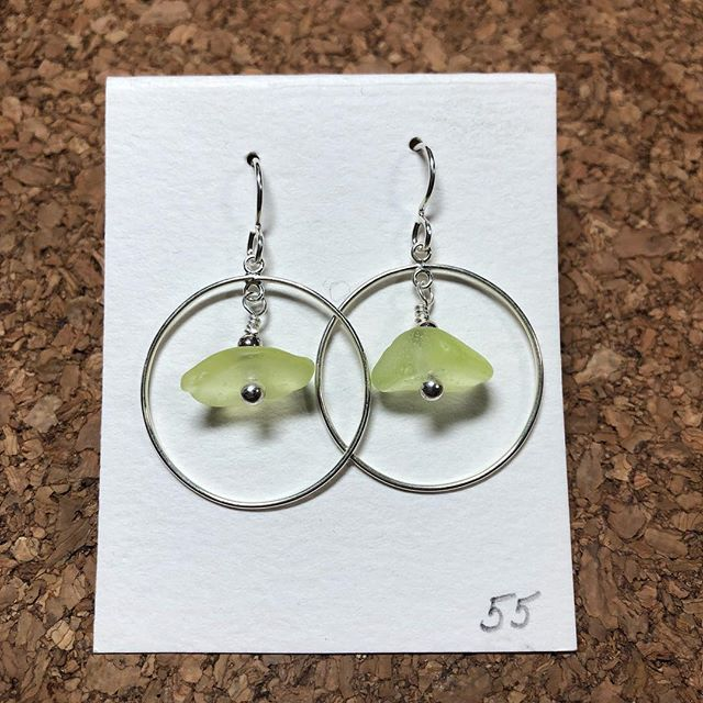 Our newest earring design! What do you think? These beauties are made with local sea glass that I found at Davenport. This unique color comes from the inside of Lundberg Studios lamps. It's radiated glass and glows under a black light! Swipe to see! #davenportseaglass #davenport #seaglassjewelry #seaglass #oceanlover #seaglassartist #seaglasshunting #seaglassaddict