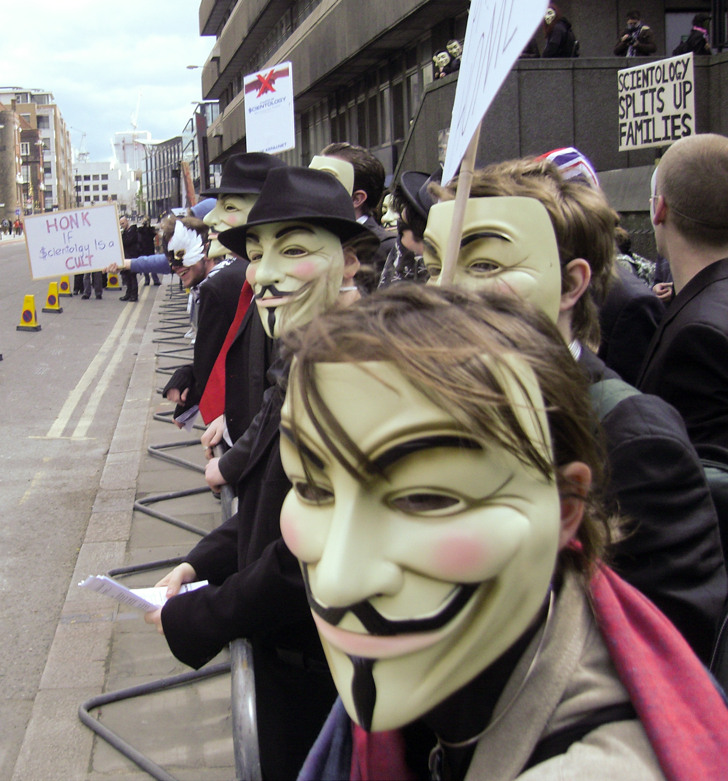 Photo of Anonymous protesting Scientology in London, by JamesHarrison [Public domain],  via Wikimedia Commons