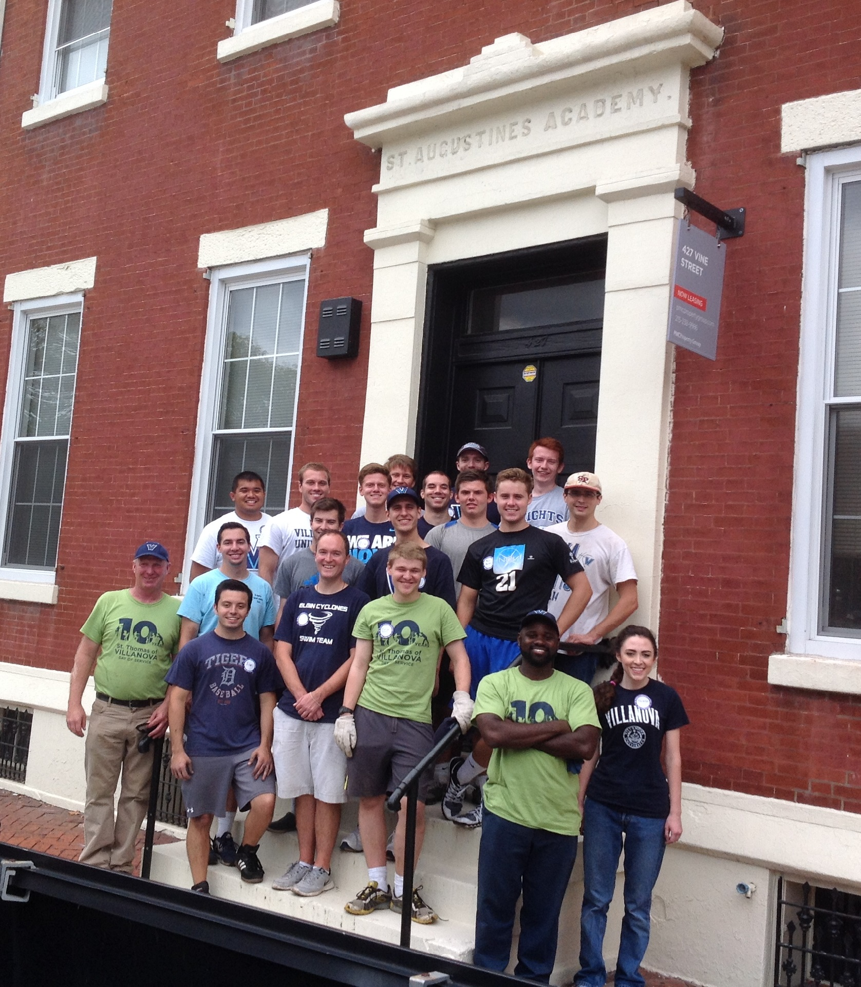 Villanova Students and Staff standing in front of the building which once housed the St. Augustine Academy at 427 Vine Street, Philadelphia where Villanova University had it's first beginnings.