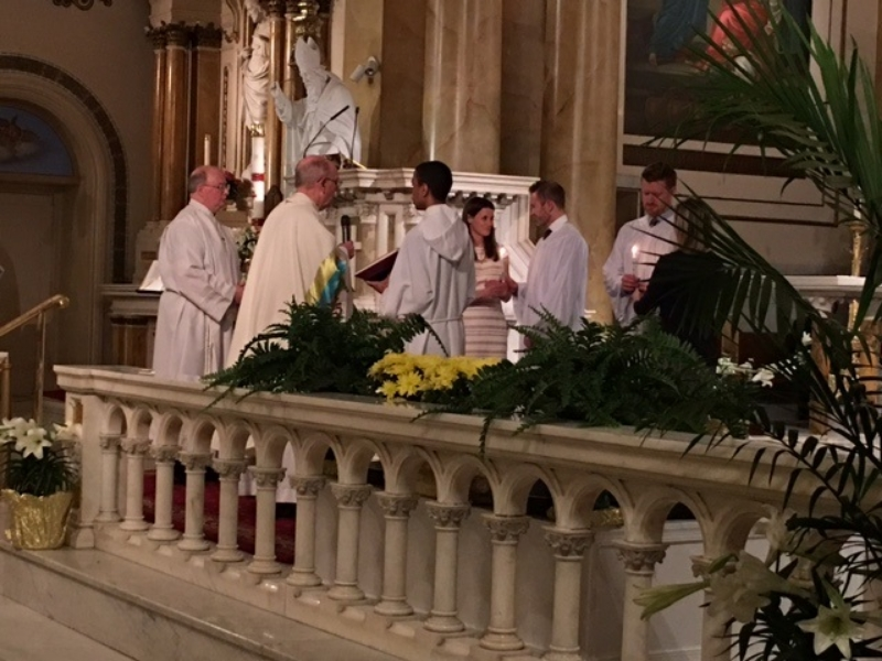 """The Newly Baptized Receiving the """"Light of Christ."""""""