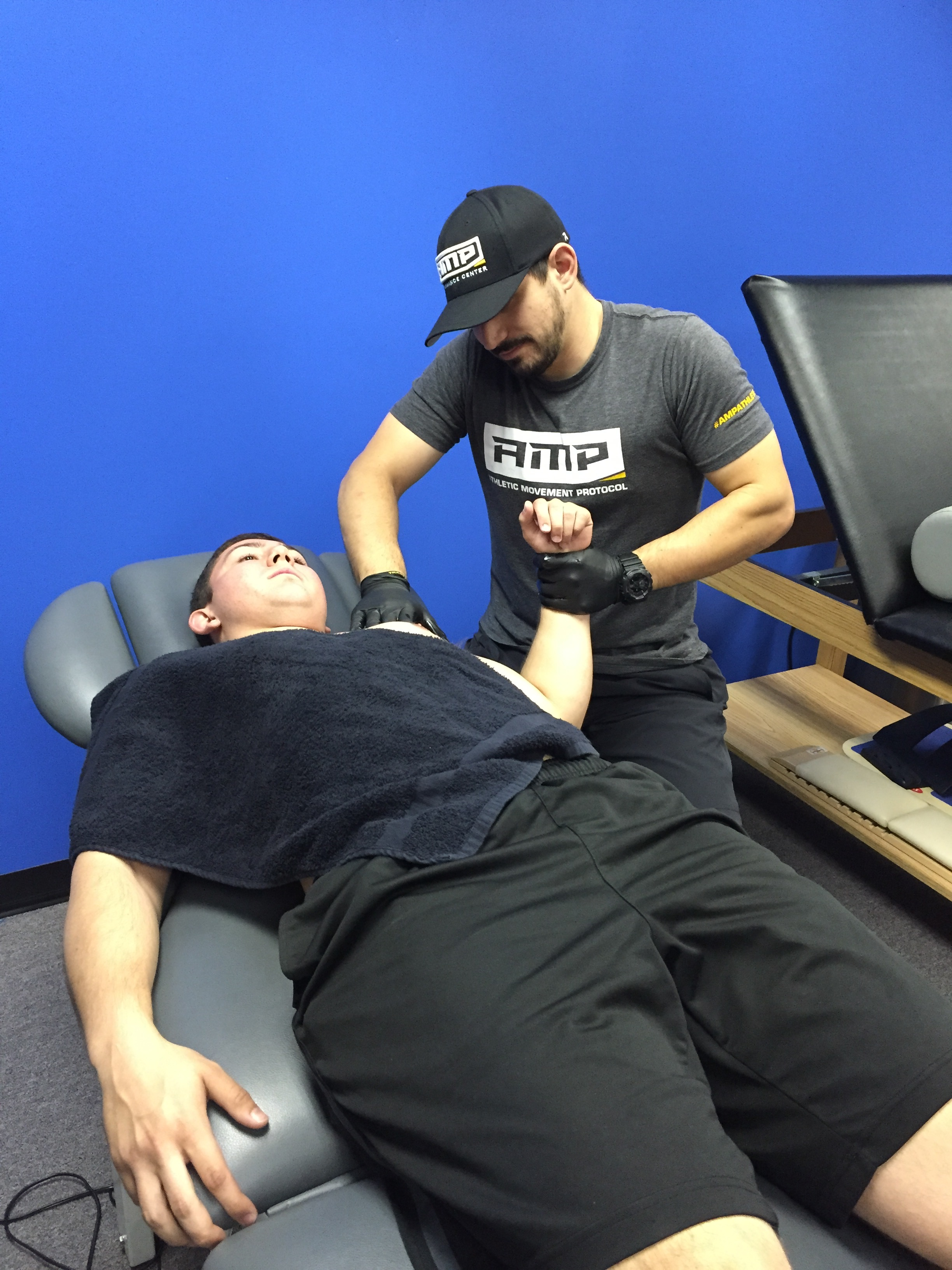 AMP Athlete Sal Pipia receives Manual Therapy on his shoulder to restore lost range of motion after surgical repair.