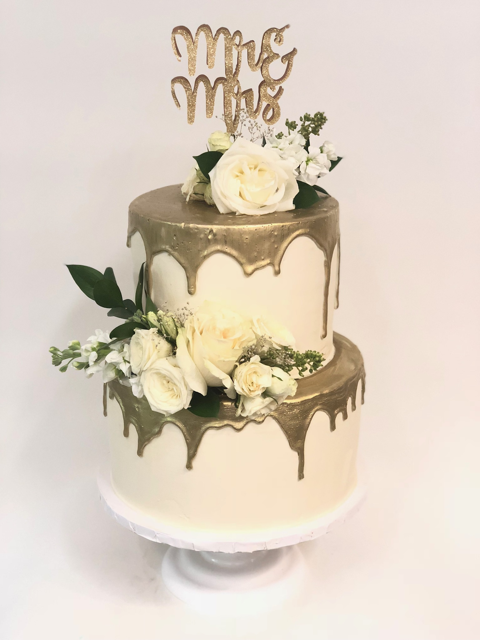gold drip buttercream cake with fresh roses