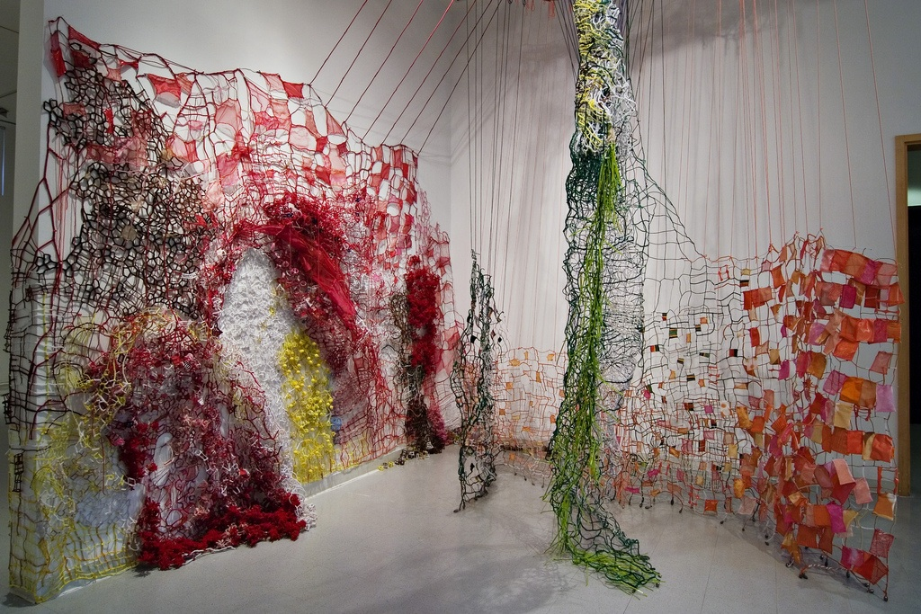 Split Barrier  , 2008 Fabric, pipe cleaners, yarn, pins, plastic, thread, fruit nets, plastic ties, styrofoam balls, tacks, and lead weights Variable dimensions
