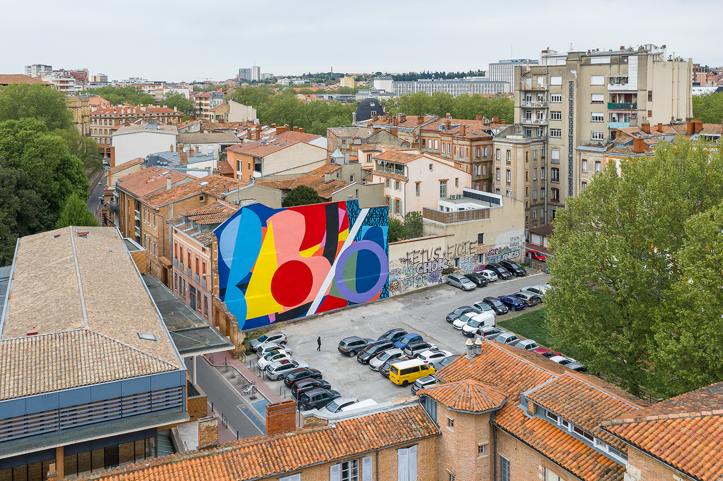 Overlapping and Intersecting Forms with Tangent Lines  , 2019  Commissioned by the City of Toulouse, France with the City of Atlanta for the Rose Beton Biennale  Acrylic on wall  46 x 82 ft.