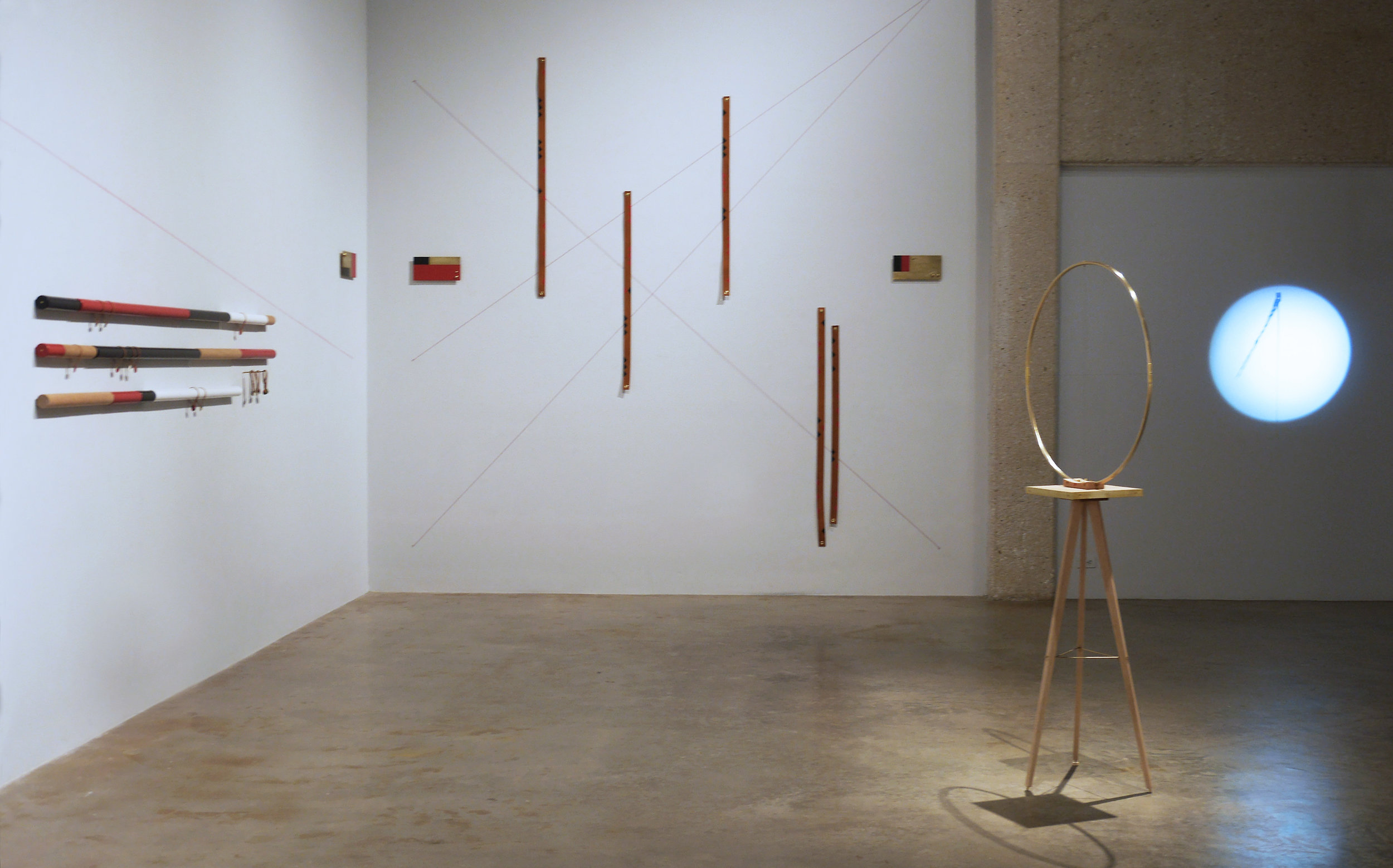 Installation of   Line of Sight  , 2018  Brass, cotton cord/string, leather, and poplar wood