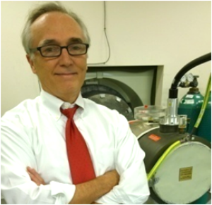 Dr. Hight with the Electron Beam CT Scanner.