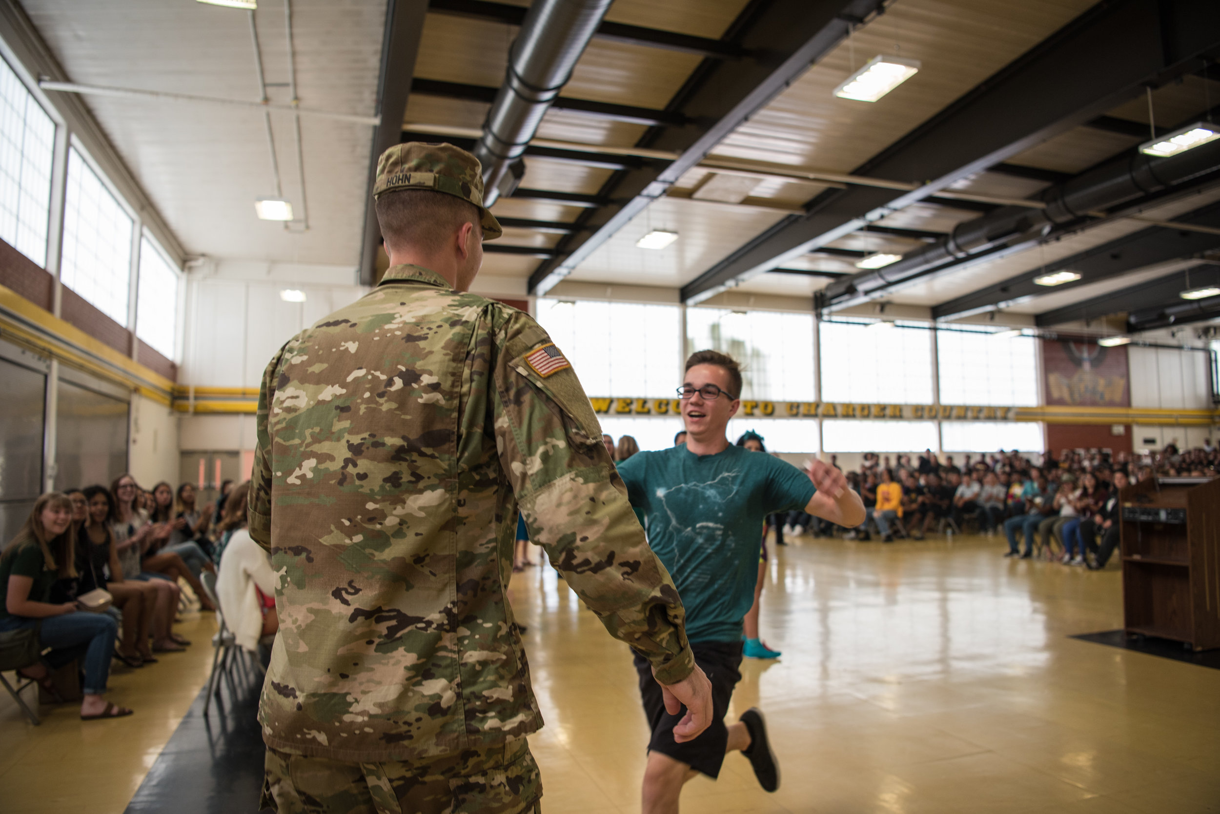 Matthew Hohn runs to embrace his brother, Army Specialist Bradley Hohn, after Bradley planned a homecoming surprise at Matthew's graduation rehearsal on Thursday, June 8, 2017, at Ed W. Clark High School in Las Vegas. Morgan Lieberman Las Vegas Review-Journal