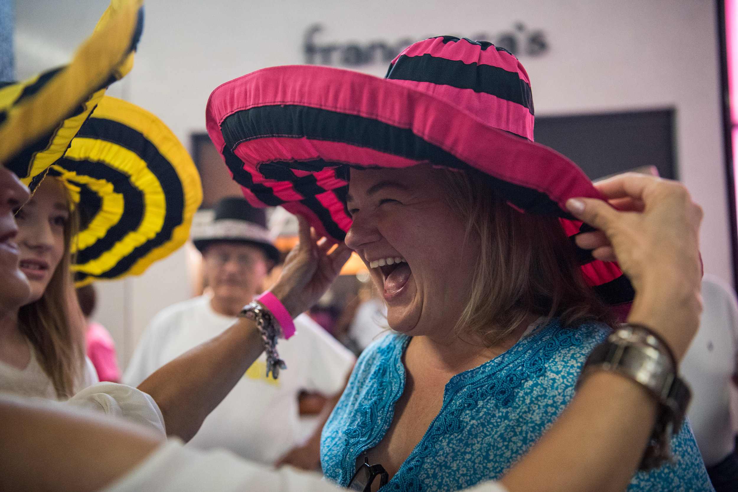 "Mimi Diebold gets a hat adjustment before the ""One Mile in Style"" on behalf of Dress for Success Southern Nevada at Miracle Mile Shops at Planet Hollywood hotel-casino on Saturday, July 29, 2017, in Las Vegas. Morgan Lieberman Las Vegas Review-Journal"