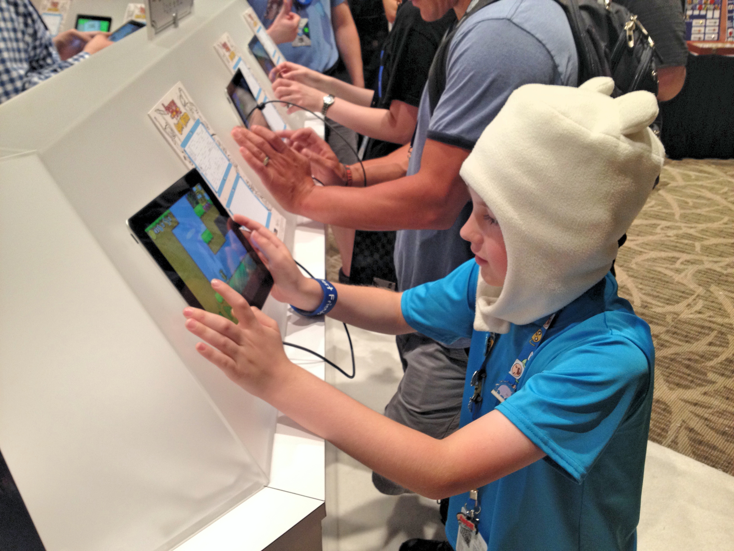A player enjoying an early beta release of Adventure Time Game Wizard in the Cartoon Network booth at Pax Prime 2014 in Seattle.  Click here  to see more pictures from this event.