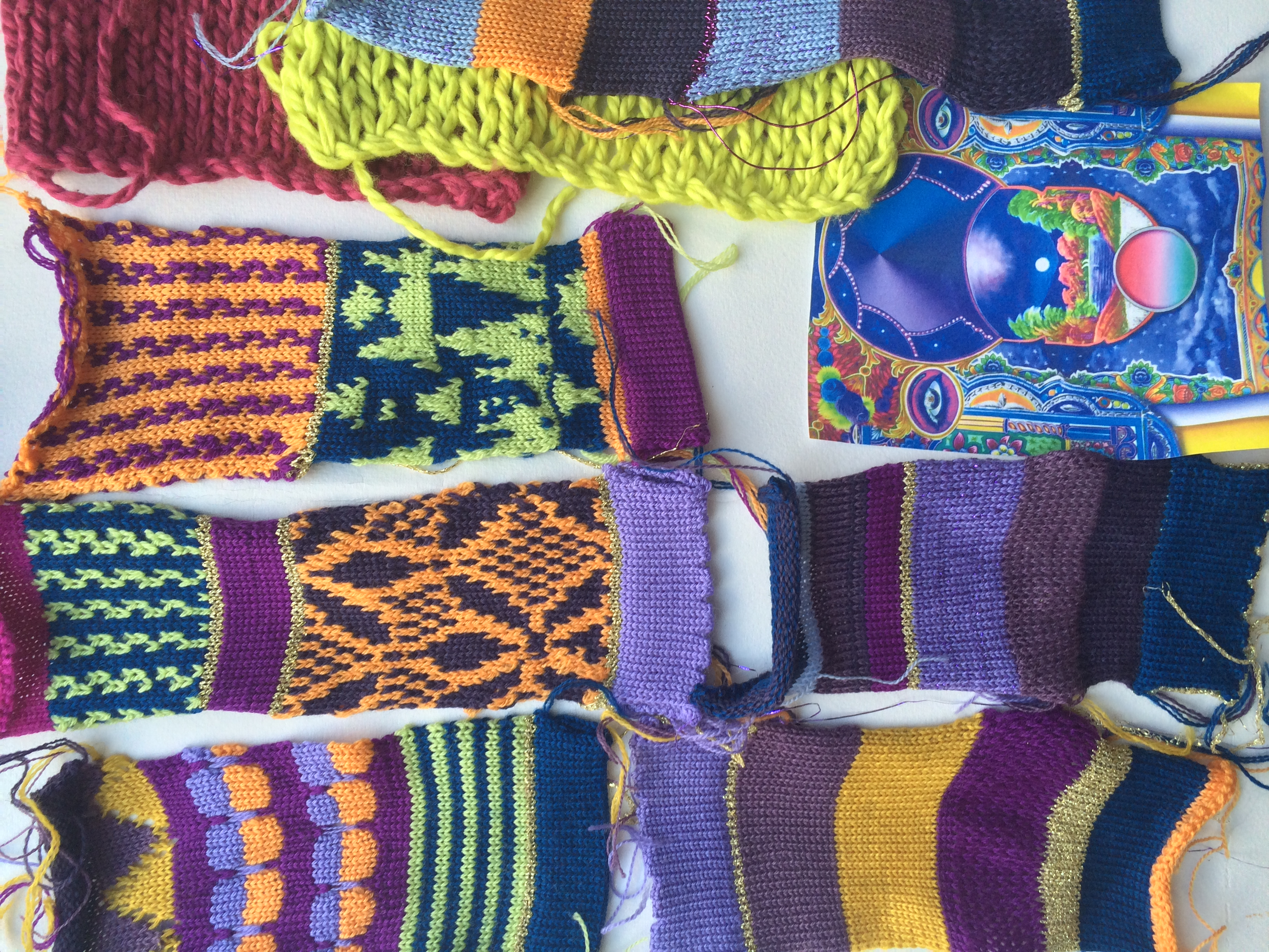 I knitted swatches based on the reference image (bottom right) before knitting the garments.