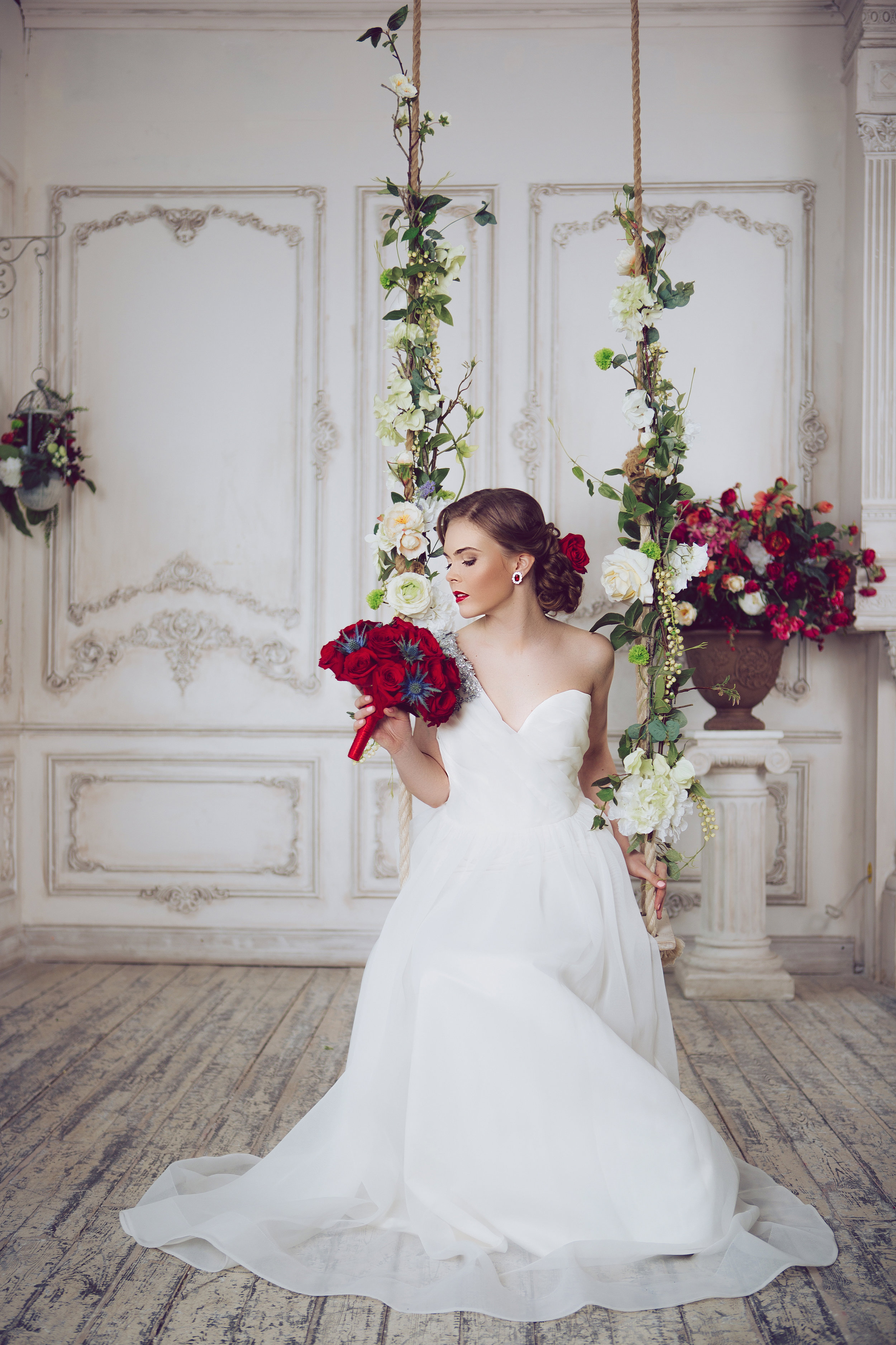 Portrait of Young Beautiful Attractive Bride with Flowers. White Dress and Wedding Decorations. Vintage Toning