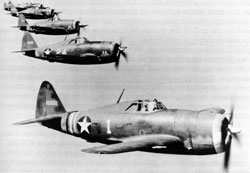 The Republic P-47, the workhorse of American aircraft in the tactical support role. The single heaviest aircraft of the war (at 10,000 lbs empty), the P-47 proved itself to be extremely capable of ground support. It was armed with eight .50 caliber machine guns and could carry 10 5 inch rockets and up to 2,500 lbs. of bombs, almost half the load of a B-17 heavy bomber. What was more, it was capable of absorbing incredible amounts of punishment, which meant that it could make repeated attacks on well-protected targets even in the face of heavy flak. Pictured here are P-47Cs flying in formation in 1942.