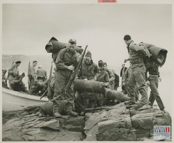 A US shore party prepares to search a section of coastline for German weather stations. Source: The National World War II Museum.