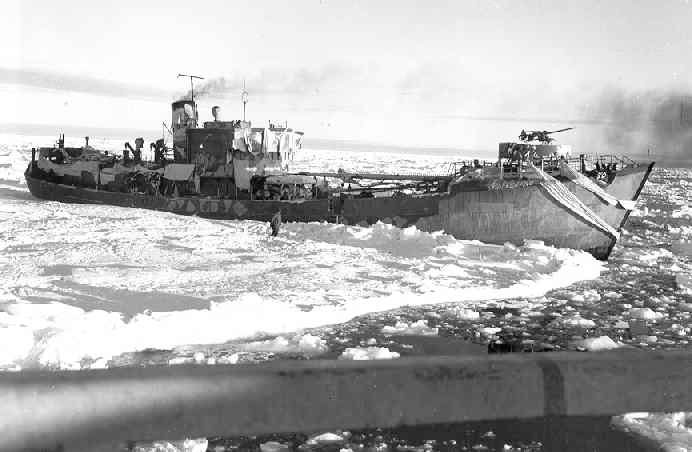 The trawler Externsteine, trapped in ice. After her capture, she was made a prize ship and rechristened USCGC Eastbreeze. She was turned over to the US Navy and renamed the USS Callao (IX-205) in January 1945. She was decommissioned in 1950 and scrapped.