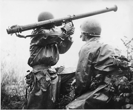 """A Bazooka team in action against North Korean armor. The 2.36"""" bazooka, ineffective during World War II against German armor, was found to be equally ineffective against the Soviet-built T-34 with its sloped armor."""