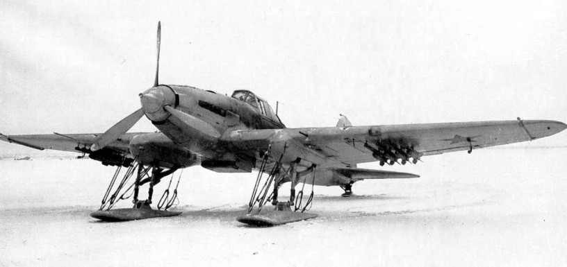A single-seater Il-2, painted in whitewash to blend into the snow-covered landscape. This aircraft has been equipped with skis to make it more suitable to the crude runways that would have been coated in ice and snow.