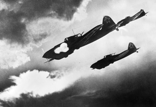 A group of Il-2s make a diving attack with their 23mm cannon.