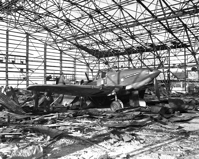 A North Korean Air Force Il-10 sits in the ruins of a destroyed hangar at Kimpo airfield.