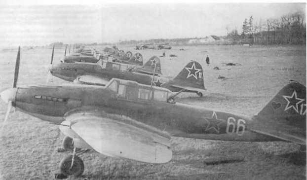 A group of Il-2M3s lined up  at an airfield.