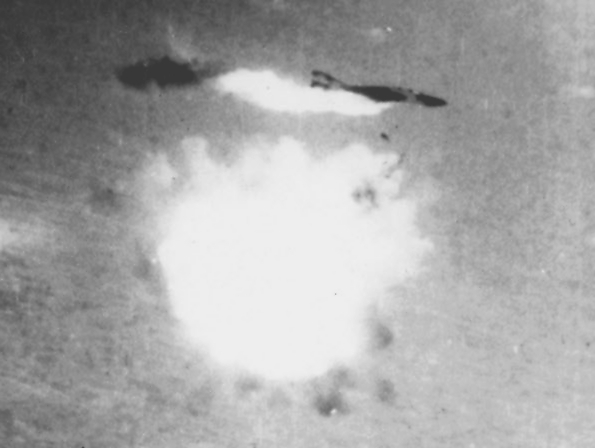 A USAF F-4 Phantom is hit by an SA-2 SAM over Vietnam.