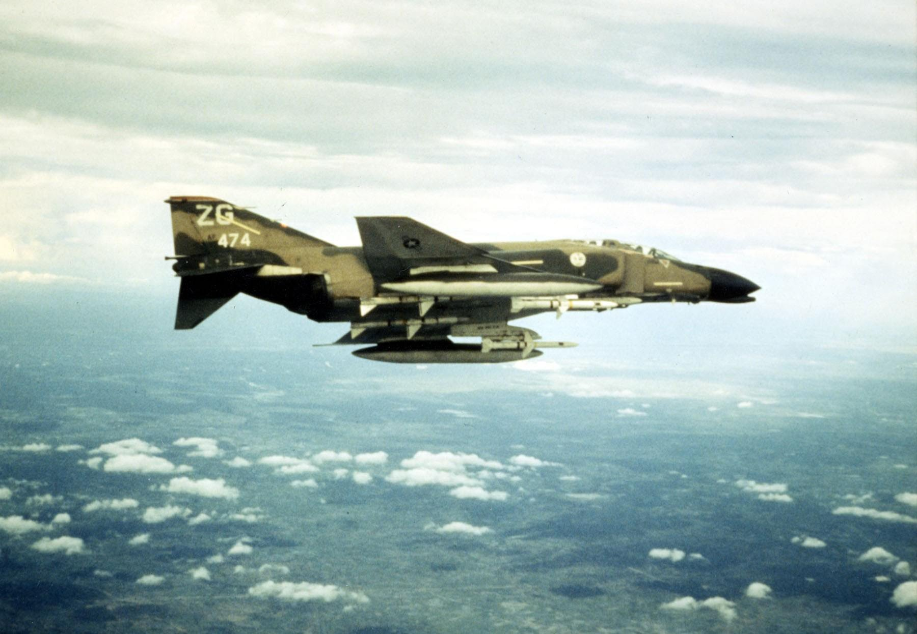 An F-4 Phatom loaded with fuel tanks and four Sparrow missiles patrols the skies above Vietnam.