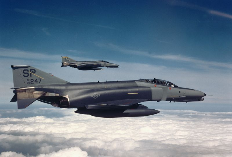 Two F-4G Wild Weasels fly in formation during the 1980s. Phantoms like these eliminated Iraqi radar systems early in the Gulf War conflict, allowing other aircraft to carry out follow on strike missions.