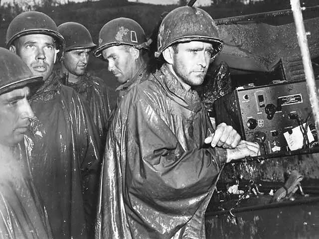 Members of the 77th Infantry Division during a rainstorm on Okinawa.