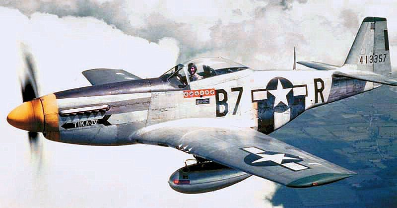 A P-51D of the 374th Fighter Squadron. Beneath the wings are 75 gallon drop tanks, which further extended the range of the Mustang. Standard practice for Mustang pilots was to drop the tanks on sighting enemy aircraft and switch to their main tanks. Source: Wikipedia.