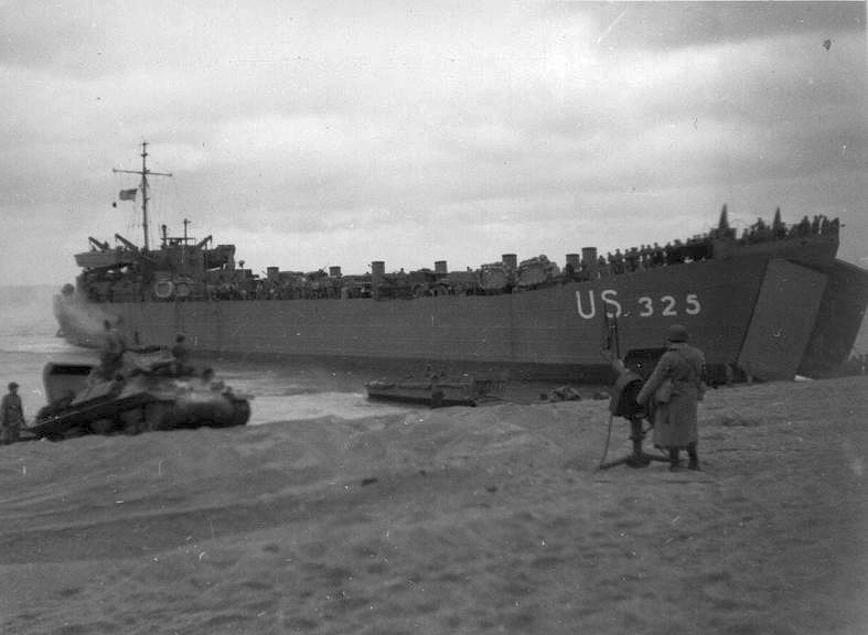 USS LST-325 beached at Slapton Sands in January 1944 during one of the exercises rehearsing the invasion of Normandy. Photo source: navsource.org.