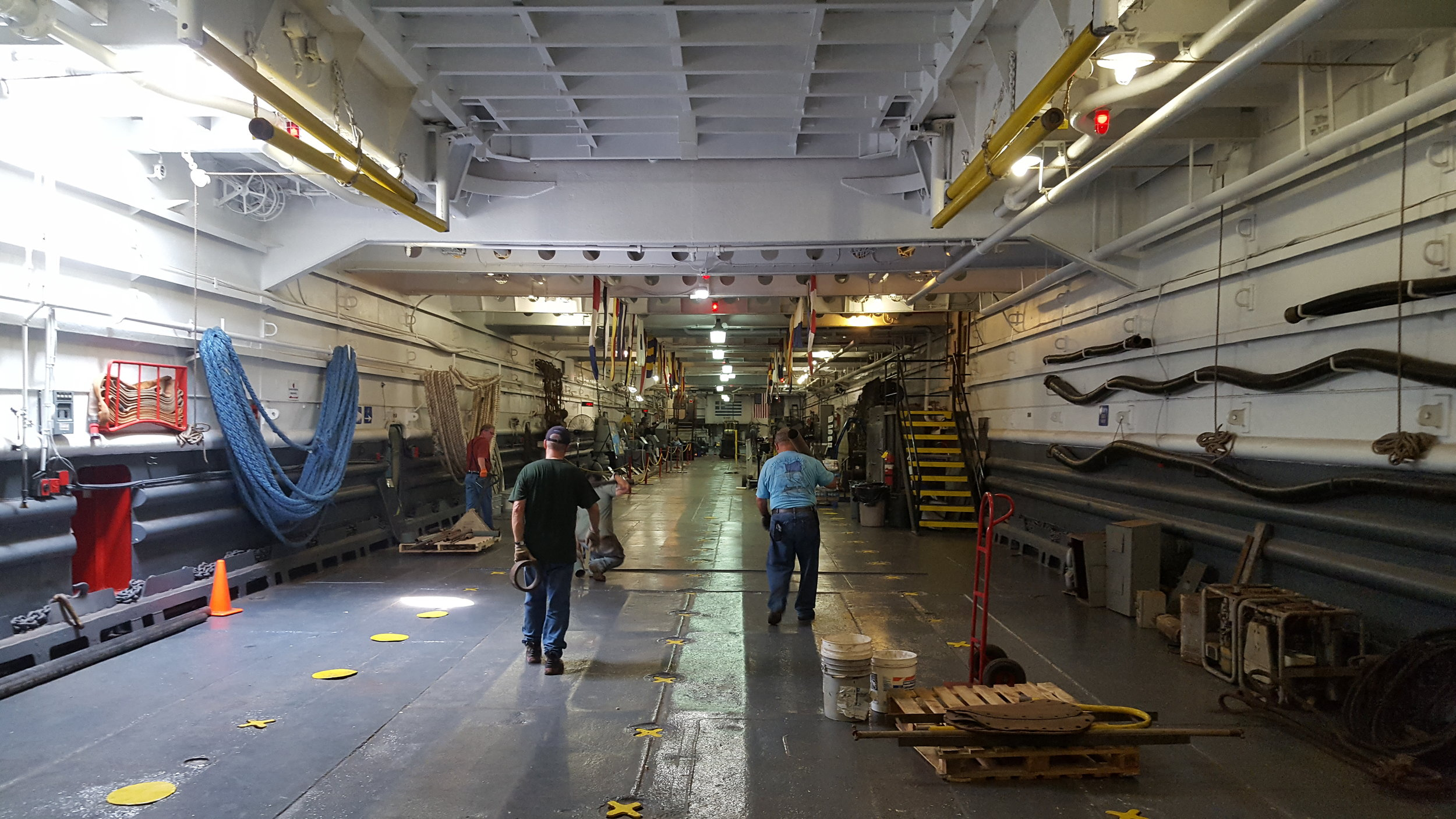 The tank deck of USS LST-325 looking aft from the bow. Much of the tank deck is currently used as exhibit space. Photo: Author.