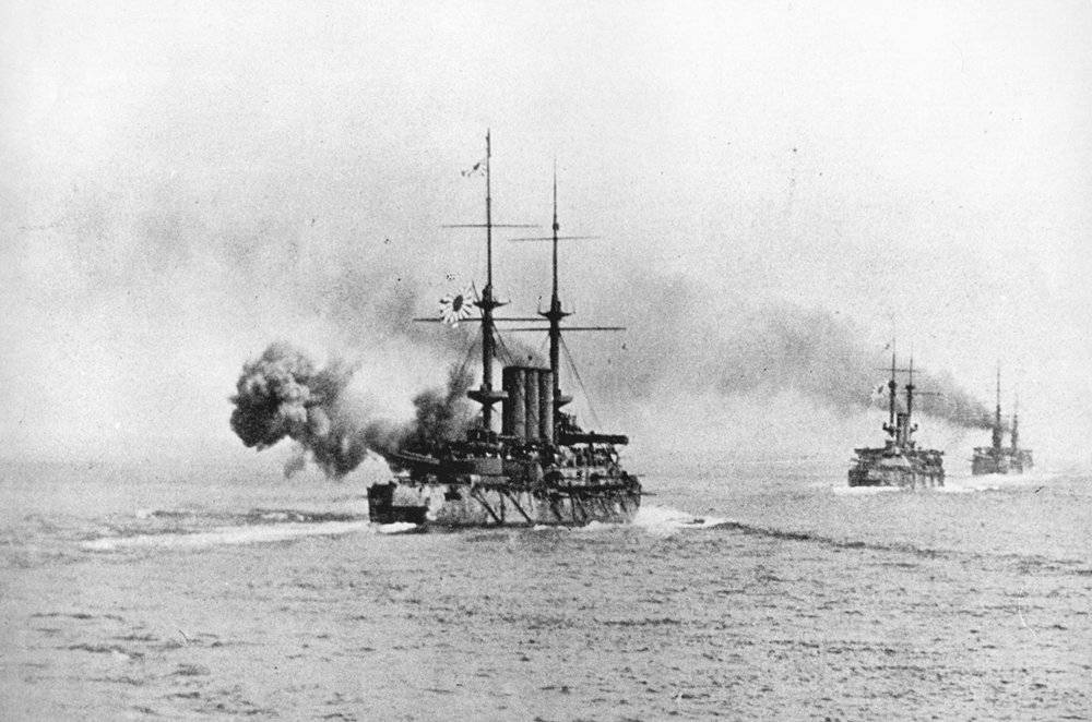 Japanese warships exchange fire with the Russian fleet during the Battle of the Yellow Sea. Photo source: Wikipedia.