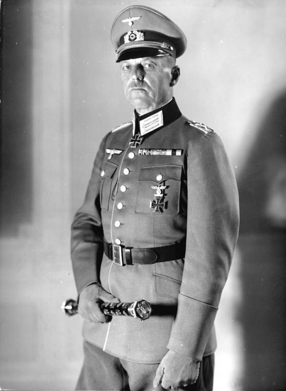 GENERAL GERD VON RUNDSTEDT, COMMANDER OF GERMAN ARMY GROUP A, WHICH SUCCESSFULLY BROKE THROUGH FRENCH DEFENSES AND SWEPT INTO FRANCE. RUNDSTEDT HAD RETIRED IN 1938 ONLY TO BE RECALLED TO ACTIVE SERVICE WHEN GERMANY INVADED POLAND. RUNDSTEDT WOULD BE SUBSEQUENTLY BE DISMISSED IN LATE 1941, THE SUMMER OF 1944, AND MARCH 1945- BY HITLER EACH TIME. AN EXCELLENT COMMANDER, HE WAS RECALLED TO SERVICE SEVERAL TIMES TO SALVAGE DEFENSIVE SITUATIONS. PHOTO SOURCE: WIKIPEDIA.